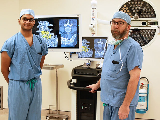 -	Schrynel D'Mello, a clinical engineer with 7D Surgical and Dr. Matthew Philips of the Spinal Surgery team at St. Luke's Hospital get a better look at a patient's anatomy with 7D Surgical Machine-vision Image Guided Surgery technology.