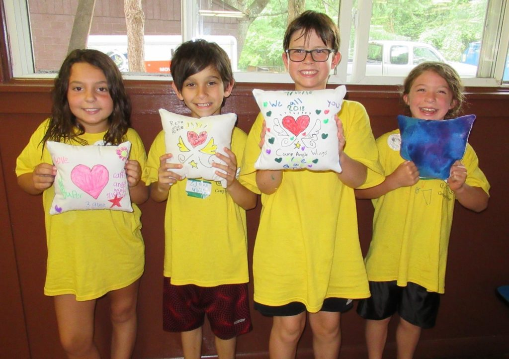 Photo with Children: Campers at Camp Angel Wings memorialize loved ones through various crafts and activities