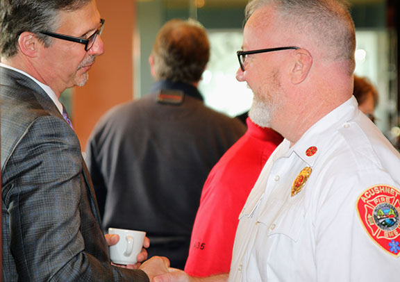 Keith Hovan, chief executive officer of Southcoast Health shakes hand with Kevin Gallagher, fire chief for the town of Acushnet, at the Southcoast Health annual EMS provider breakfast.