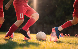 youth soccer players in red