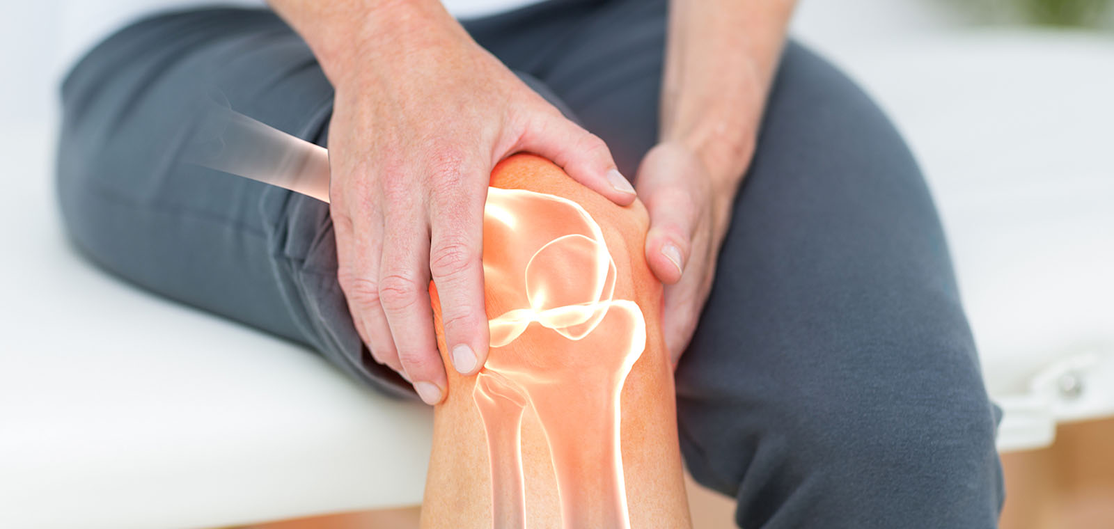 Digitally composite image of man suffering with knee pain