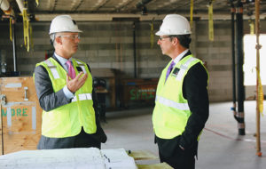 Mayor Jon Mitchell joined Southcoast Health President & CEO Keith Hovan on a tour of the future site of a new, $14 million intensive care unit under construction at St. Luke's Hospital. The leaders are shown here looking over design plans