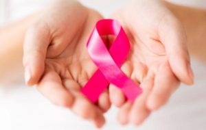 Pink ribbon in hands